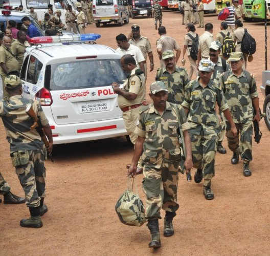 Paramilitary personnel leaving for their assigned booths in Udupi on Friday.