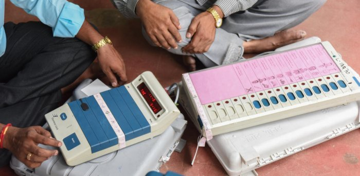 Poll duty officers and employees collecting the EVM, VVPAT Machines and seen checking the materials given to them for the purpose of the election and leaving to polling station after collecting the materials due to Vidhana Sabha Election at DRR Polytechni