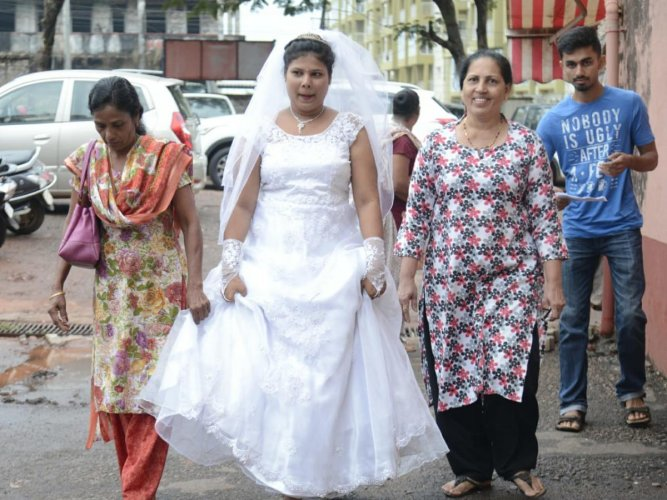 Newly-wed bride Viola Maria Fernandes comes to cast her vote at the Saint Lawrence English School at Bondel in Mangaluru on Saturday.
