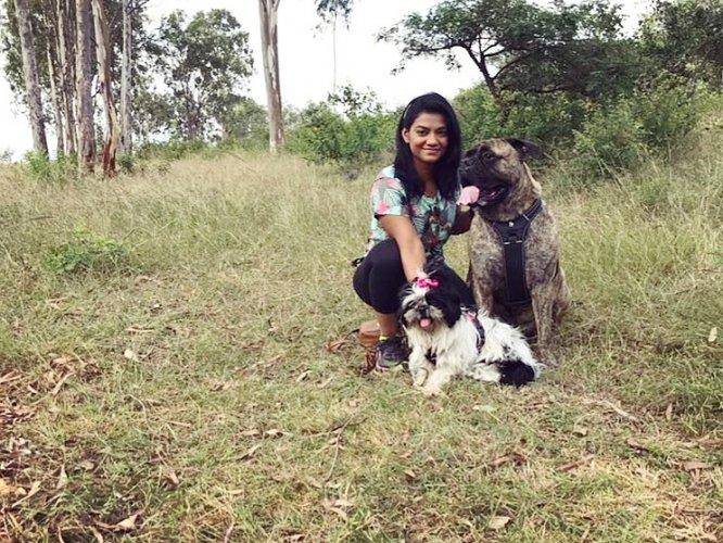 Madhurima Bhattacharjee with Bullmastiff Zorro and Shih Tzu Bella.