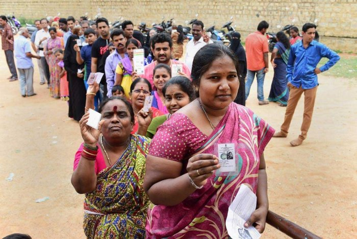 People queue up to cast their ballot during the polling day for the Karnataka Assembly election 2018 in Bengaluru on Saturday. PTI Photo