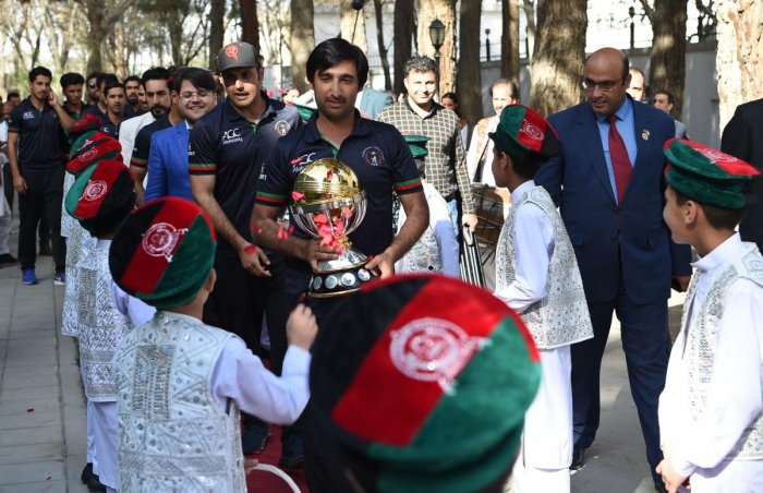 Afghan cricket captain Asghar Stanikzai (C) and teammate Mohammed Nabi (C-L) arrive for an event to celebrate the Afghan national team qualification to the 2019 cricket World Cup in Kabul on March 27, 2018. Afghanistan's cricket team received a hero's wel