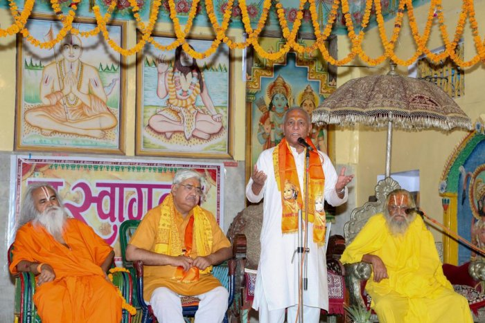 Newly elected Vishwa Hindu Parishad (VHP) chief Vishnu Sadashiv Kokje addresses a meeting of sadhus, in Ayodhya on Monday. PTI Photo