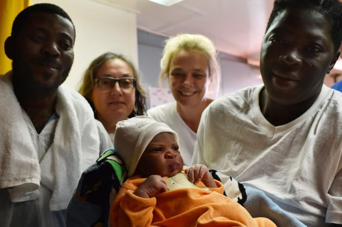Bernadette Obiona and David Dibonde (L) with their newborn baby. AFP