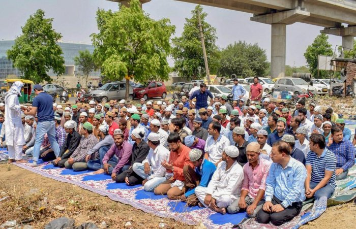 People offer namaz under police presence (unseen), after the recent disruptions by Hindu activists organisations, in Gurugram on Friday. PTI Photo