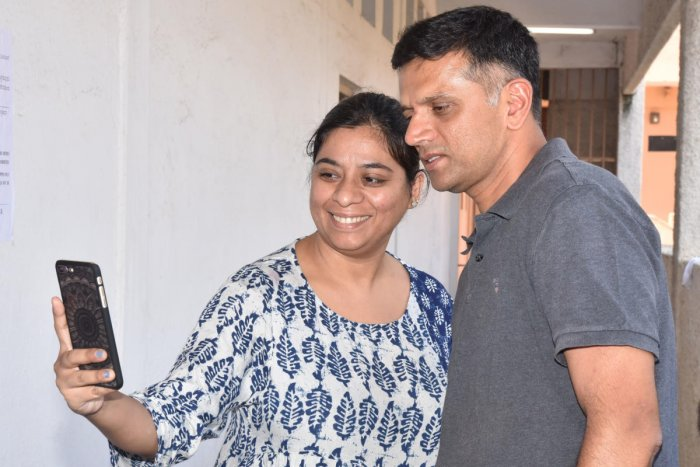 A woman take selie with Rahul Dravid, Cricketer and Karnataka Election Commission brand ambassador at Shanthi nagar legislative assembly constituency election in Dr Ambedkar First Grade College, HAL 2nd stage, Indiranagar, Bengaluru on Saturday. Photo by