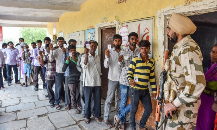 Men stand queue to exercise their franchise for Assembly Election Kalaburagi South at Bhimalli Polling Station in Kalaburagi Taluk on Saturday. DH Photo for representation only.