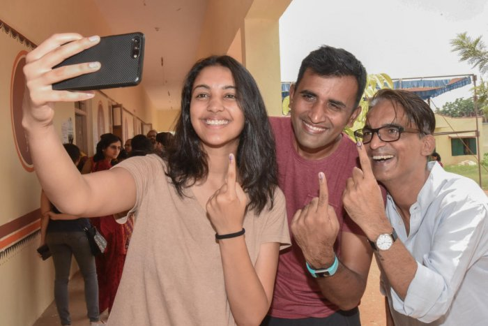 Family members taking selfie after cast vote at Mahadevapura legislative assembly constituency election at Government Higher Primary School at Hoodi in Bengaluru on Saturday. Photo by S K Dinesh