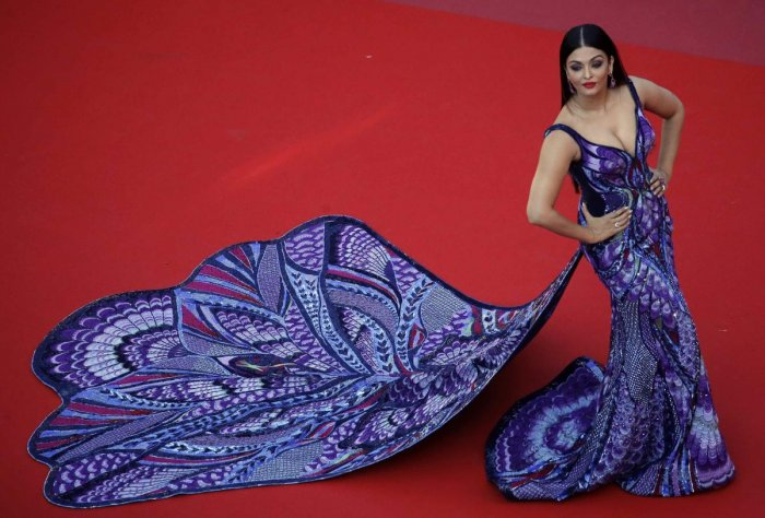 The outfit, designed by Dubai-based couturer Michael Cinco, was patterned with Swarovski crystals and French palettes. Ultra-violet, midnight blue, and red thread works added extra details to the gown.