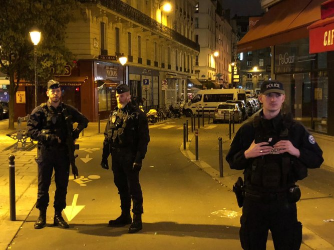 French police secure a street after a man killed a passer-by in a knife attack in the heart of Paris and injured four others before being shot dead by police, according to French authorities in Paris, France, May 12, 2018. REUTERS