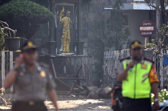 Police are seen outside the Immaculate Santa Maria Catholic Church following a blast, in Surabaya, East Java, Indonesia May 13, 2018 in this photo taken by Antara Foto. Antara Foto/M Risyal Hidayat / via REUTERS