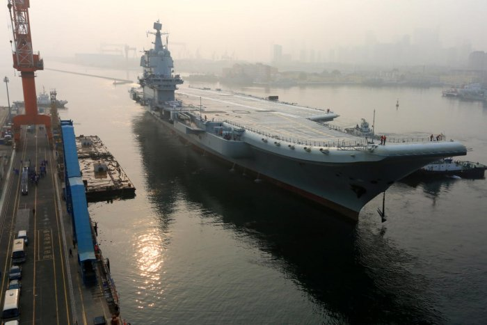 China's first domestically developed aircraft carrier departs Dalian, Liaoning province. Reuters photo