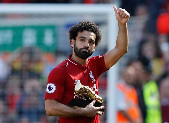 Record breaker: Liverpool's Mohamed Salah celebrates with golden boot after beating Brighton & Hove Albion on Sunday. Reuters