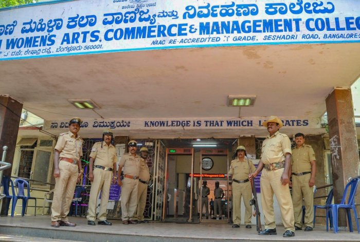 Police personnel stand guard outside a counting centre after the Karnataka Assembly Elections 2018 in Bengaluru on Monday. PTI Photo