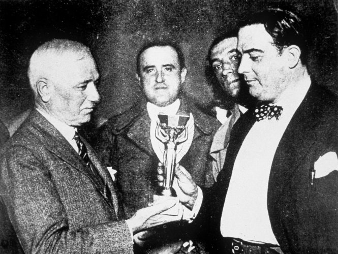 Jules Rimet (left) presents the first World Cup trophy (the Jules Rimet Trophy) to Dr Raul Jude, the president of the Uruguayan Football Association.