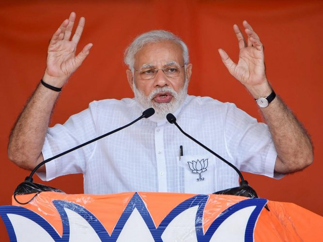 Prime Minister Narendra Modi speaks during an election campaign rally ahead of Karnataka Assembly Elections, at Chikmagalur in Karnataka on Wednesday.