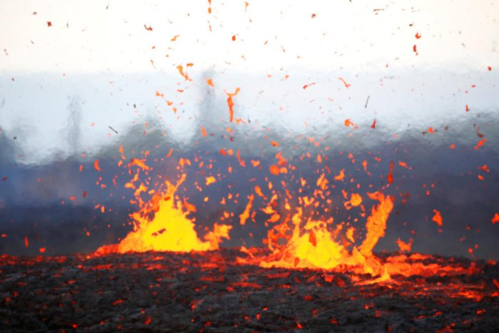 Lava erupts from a fissure on the outskirts of Pahoa during ongoing eruptions of the Kilauea Volcano in Hawaii, U.S., May 14, 2018. Reuters