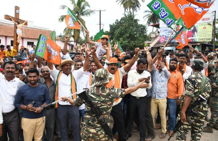 BJP workers rejoice outside the counting centre in Mangaluru to celebrate the sweeping victory of the party in DK on Tuesday.