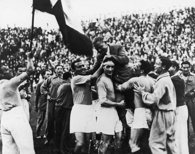 Italy players lift their coach Vittorio Pozzo after winning the final against Czechoslovakia in Rome. Italy won the match 2-1 after extra-time.