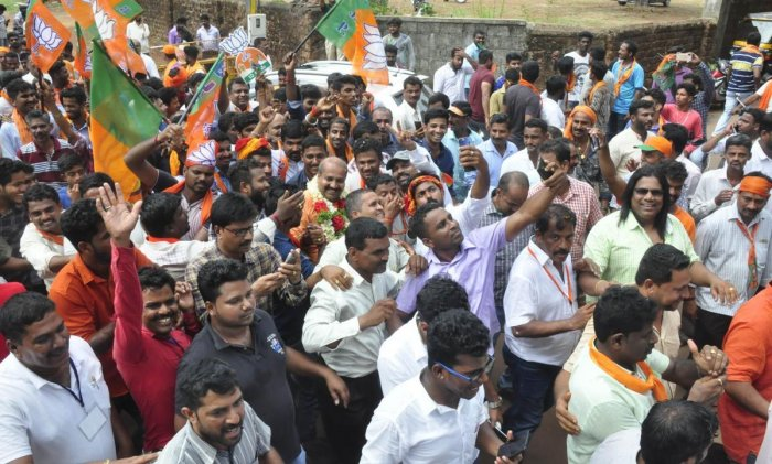 BJP workers celebrate the victory of Raghupathi Bhat in Udupi on Tuesday.