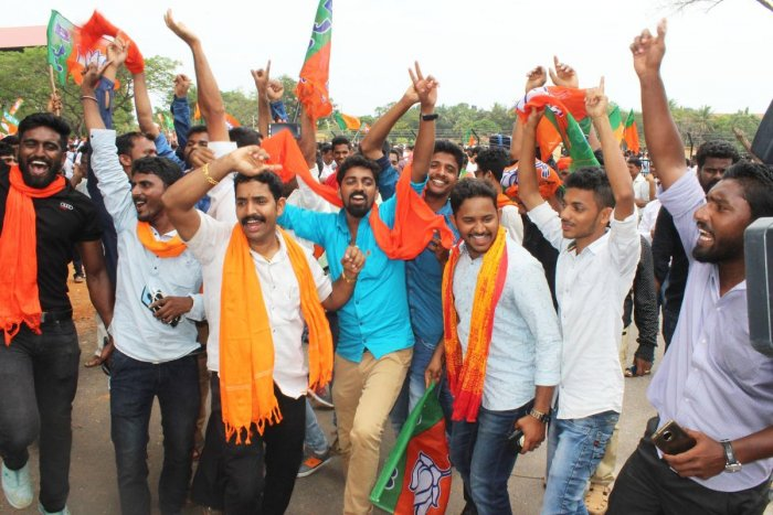 BJP party workers in Udupi celebrating after the results were announced on Tuesday.