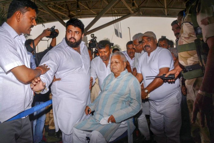 RJD Chief Lalu Prasad Yadav, after being granted bail for six weeks, arrives at Birsa Munda International Airport, in Ranchi, on Wednesday. PTI