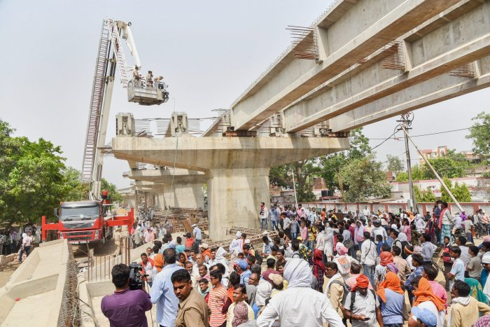 Rescue and relief works in progress at the flyover-collapse site in Varanasi on Wednesday, a day after the mishap. PTI