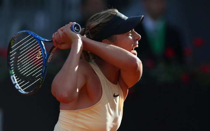 GRUELLING: Russia's Maria Sharapova reacts during her match against Australia's Ashleigh Barty. AFP