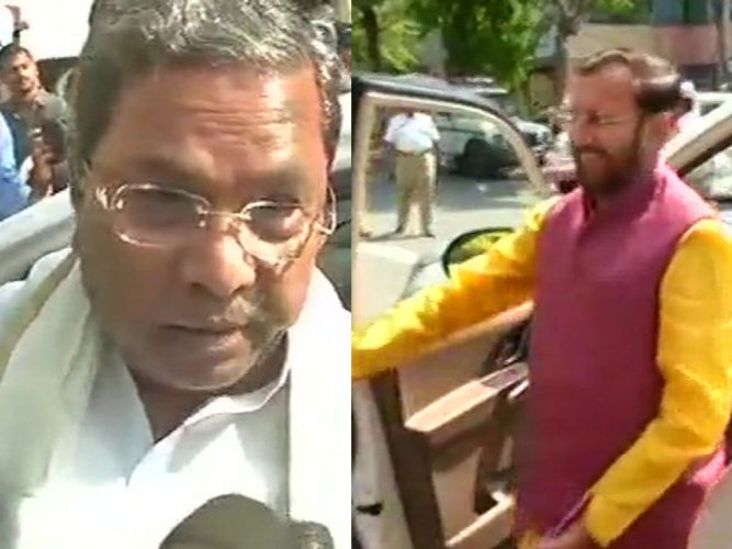 Siddaramaiah and Javadekar arrives at their party offices for deliberations. ANI photos