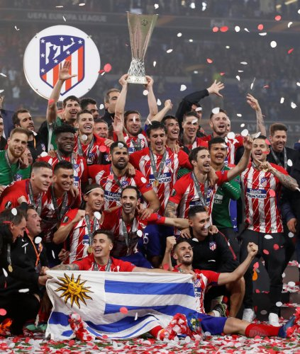Champions: Atletico Madrid players celebrate with the Europa League trophy after beating Marseille 3-0 in the final. Reuters