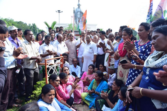 District Congress Committee staged a protest against Governor for not allowing the Congress and JD(S) coalition to form the government. They staged a demonstration in front of the Mahatma Gandhi statue at Town Hall Park in Mangaluru on Thursday.