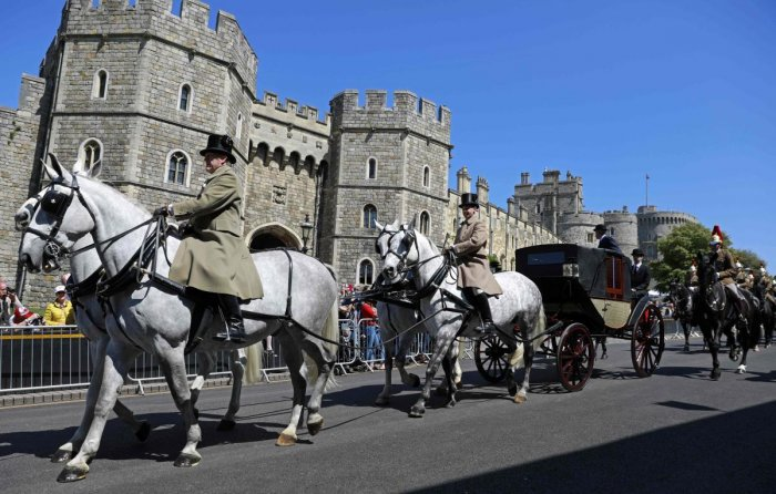 The Ascot Landau carriage pulled by Windsor Grey horses, is taken past the Henry VIII gate during a rehearsal for the wedding procession outside Windsor Castle in Windsor on Thursday. Britain's Prince Harry and US actor Meghan Markle will marry on Saturda