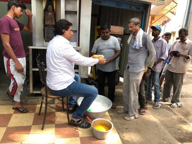 Mohammed Farooq of Al-Aman Educational and Welfare Trust serving food.