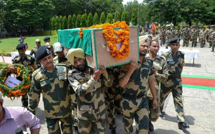 Border Security Force officers and jawans carry the coffin of Sitaram Upadhyay during his wreath-laying ceremony, at BSF HQ Campus Paloura, in Jammu, on Friday. Upadhyay was killed in ceasefire violation by Pakistani army along the international border. PTI