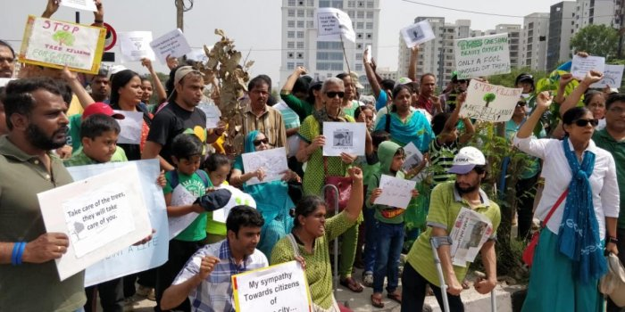 Residents stage a protest on Saturday against the recent axing of trees on the Outer Ring Road.