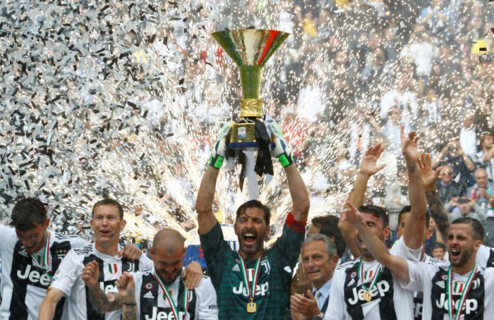 Gianliugi Buffon with the trophy after Juventus title victory.