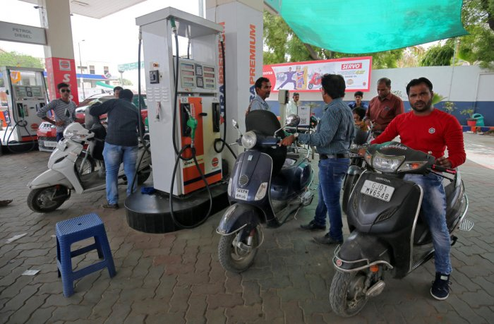 People get their two-wheelers filled with petrol at a fuel station in Ahmedabad, India, May 14, 2018.
