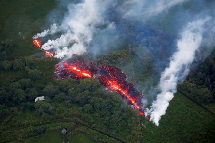 Lava erupts from a fissure east of the Leilani Estates subdivision during ongoing eruptions of the Kilauea Volcano in Hawaii, U.S., May 13, 2018