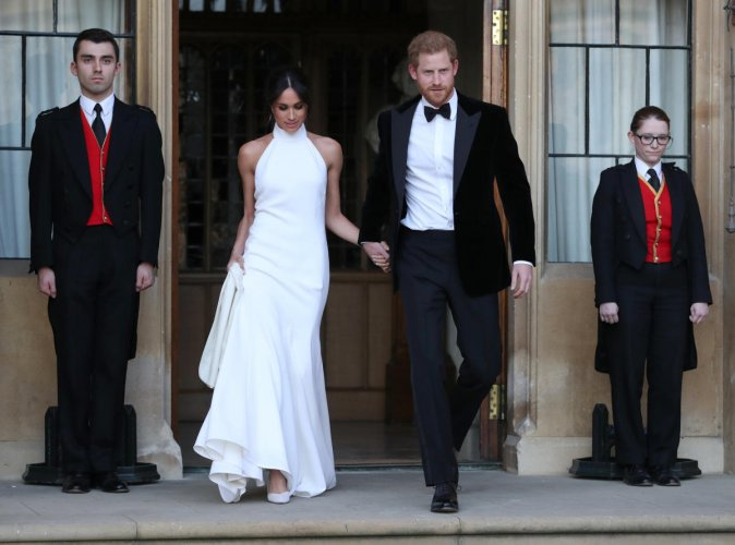 The newly married Duke and Duchess of Sussex, Meghan Markle and Prince Harry, leaving Windsor Castle after their wedding to attend an evening reception at Frogmore House, hosted by the Prince of Windsor, Britain, May 19, 2018