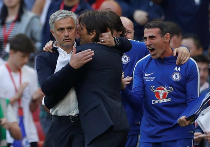 FRIENDS OR FOES?: Manchester United manager Jose Mourinho congratulates Chelsea manager Antonio Conte. Reuters