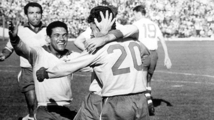 Garrincha (left) celebrates with team-mates after Brazil's third goal in the 1962 World Cup final. FIFA