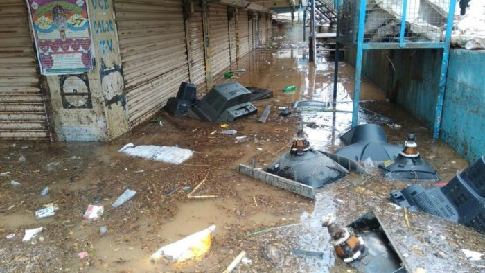 Television sets float in rainwater in the cellar of a shopping complex at the Clock Tower Circle in Koppal on Sunday. dh photo