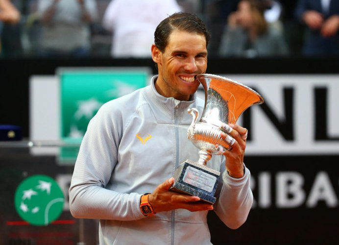Spain's Rafael Nadal celebrates with the trophy after winning the Italian Open final against Germany's Alexander Zverev. Reuters