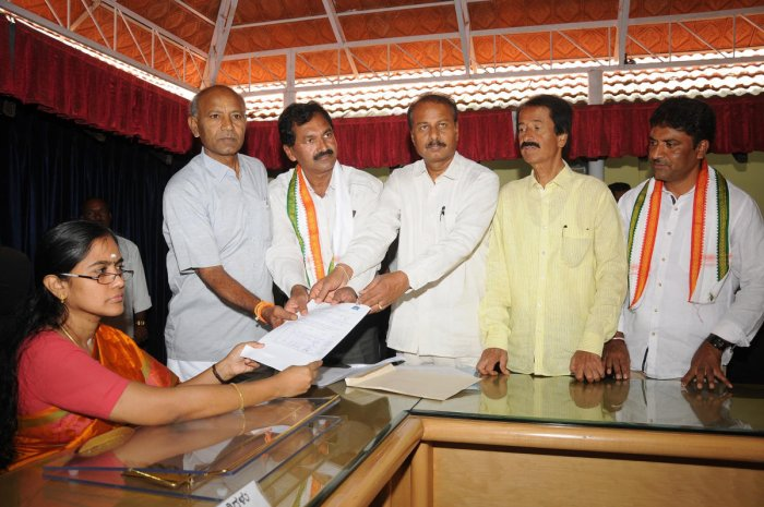 M Lakshmana of the Congress, files nomination papers with Mysuru Regional Commissioner P Hemalatha, also Election Officer, to contest in the biennial elections from the South-West Teachers constituency to the Legislative Council in Mysuru on Monday. MP R