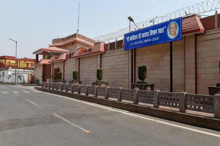 """A sign board that reads """"Sri Kanshiram Ji Yadgar Vishram Sthal"""", put up on former chief minister Mayawati's government bungalow, which she has to vacate as per the Supreme Court's directives, in Lucknow, on Monday. PTI"""
