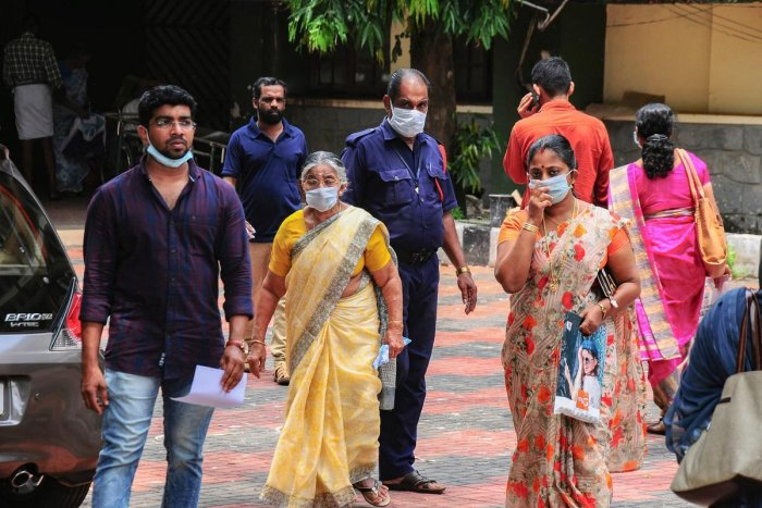 Hospital staff and family members of the patients admitted at the Kozhikode Medical College wear safety masks as a precautionary measure after the 'Nipah' virus outbreak, in Kozhikode, on Monday. PTI Photo