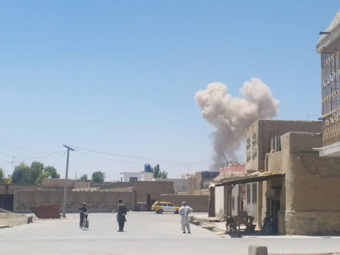 A cloud of smoke is seen after an explosion in Kandahar, Afghanistan May 22, 2018 in this picture obtained from social media. AZEEM ZMARIAL/via REUTERS