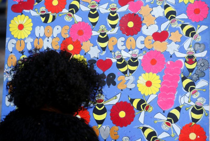 A woman looks at a tribute in St Anne's Square on the first anniversary of the Manchester Arena bombing, in Manchester. Reuters Photo