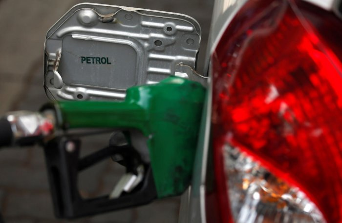 Petrol prices rose to Rs 76.87 per litre in Delhi on Tuesday, but in all other metropolitan cities, the rates touched Rs 80 per litre,while in Mumbai it was only 30 paise less than Rs 85. Reuters Photo