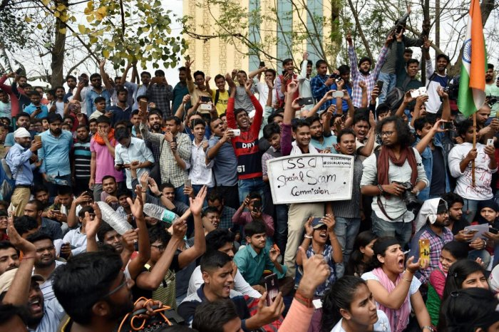 Staff Selection Commission (SSC) aspirants stage a protest over the alleged paper leak of SSC, demanding a CBI investigation, in New Delhi, on Sunday. PTI File Photo